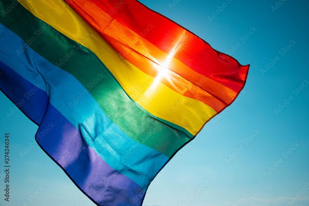 Fototapeta rainbow flag waving on the blue sky