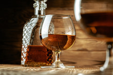 Cognac Or Whiskey In Glasses On Rustic Backgrpund