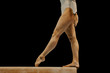 balance beam legs women athlete gymnast on black background