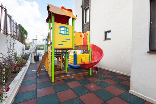 Foto op Aluminium Koraal Playground kid zone in a hotel rest territory. Modern children playground, Children playground on yard activities in park