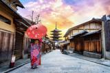 Young women wearing traditional Japanese Kimono with japan umbrella at Yasaka Pagoda and Sannen Zaka Street in Kyoto, Japa