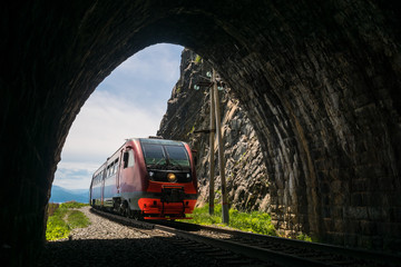 An electric train enters the tunnel