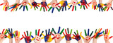 Fototapeta Tęcza - Children's smiling colorful hands raised up. The concept of classroom or back to school