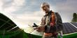 Leinwandbild Motiv Solar energy engineer using tablet for check power station smiling