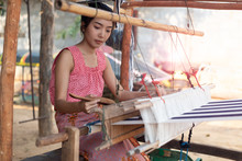 Young Women Weaving With Tradi...