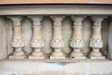 Neo Classical Architecture Details On The Old Building. Stone Sculpted Pillars On The Balcony Facade.