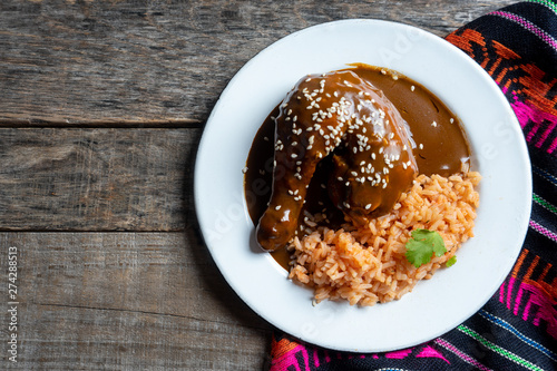 Obraz na plátně Mexican chicken with mole sauce and red rice