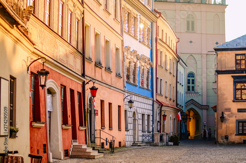 Obraz Slanted colorful houses in the old town in Lublin, Poland - fototapety do salonu