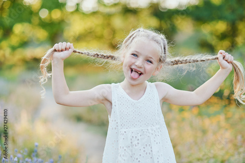 Photo  Funny girl holding hair plaits