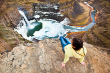 A Woman Takes In The View Of The Beautiful 180-foot Palouse Falls During A Nice Winter Day In Southeastern Washington.