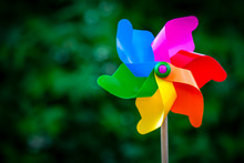 Colorful Pinwheel Against Green Background