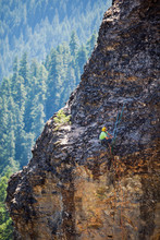 A Man Rests After Topping Out On The Incredibly Overhung 5.11a Pitch 3 Of The Turkey Monster, A 350  Foot Four-pitch Spire At The Menagerie In Central Oregon.  The Formation Is The Free-standing Remnant Of Ancient Lava Tubes And Is Climbed Usually Only Once A Year Because Of The Loose Rock. The Pictured Route, The Dod Route, Is Normally Just An Aid Climbing Route Because Of The Volatile Nature Of The Rock. Wallace And Bekah Herndon Free Climbed The Monster.