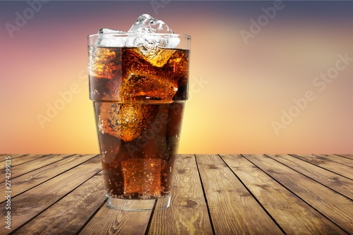 Glass of cocktail   with ice on   background