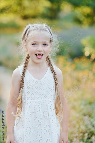 Funny girl holding hair plaits Tablou Canvas