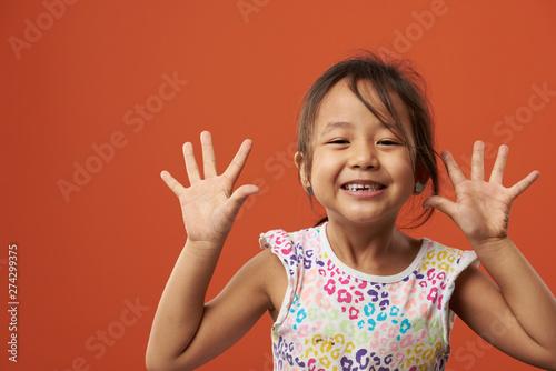 Foto  Playful asian girl portrait