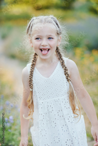 Funny girl holding hair plaits Fototapet