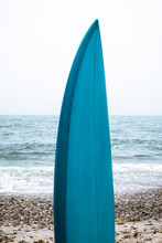 Blue Surfboard On Beach