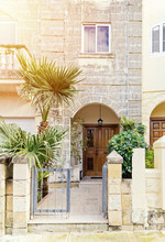 Rowhouse With Porch Is Typical Residential Building Of Malta