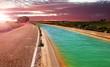 canvas print picture - Infraestructuras para agricultura y servicios rurales. Canal de gua para regadío de campos.