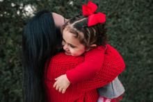 Mother And Little Daughter †they Hug In A Park