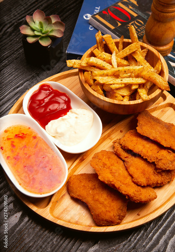 Fototapeta Chicken nuggets  served with french fries. obraz