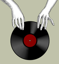 Woman's Hands Holding A Vinyl Record