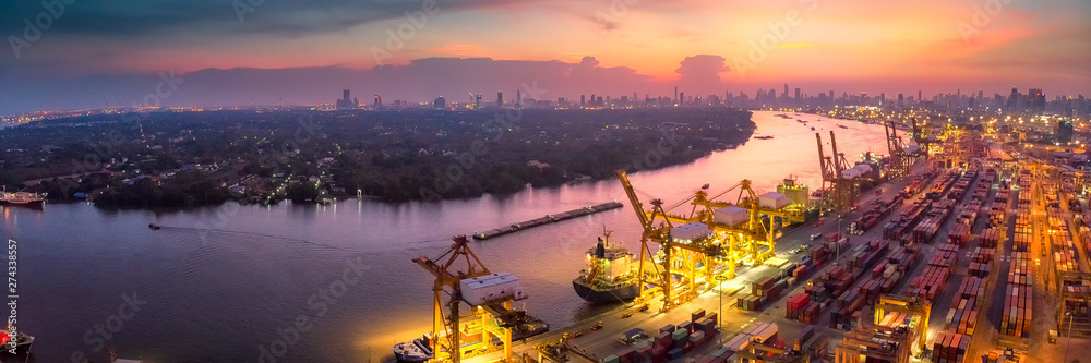 Fototapeta Logistics and transportation of Container Cargo ship and Cargo plane with working crane bridge in shipyard at sunrise, logistic import export and transport industry background