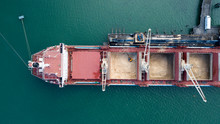 Top Down Aerial View Of Container Ship Unloading Sugar Shipment At Cargo Depot 4k