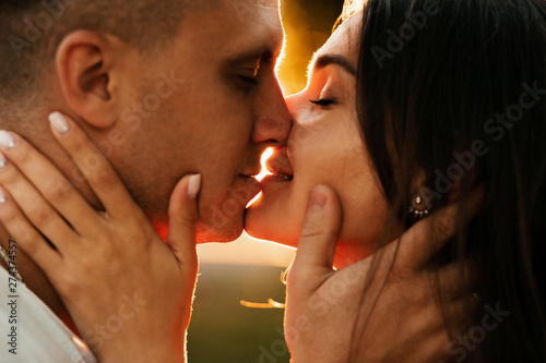 Fototapeta  young couple in love at sunset.portrait photos of lovers