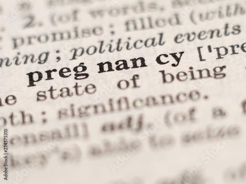 Fényképezés  Dictionary definition of word pregnancy, selective focus.
