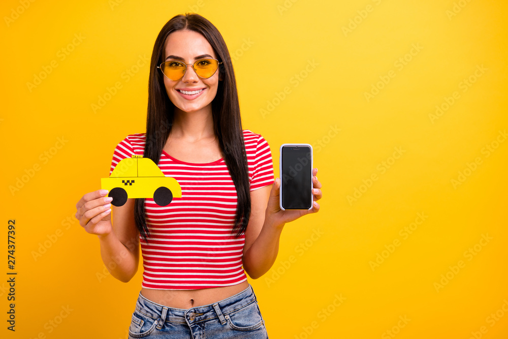 Fototapety, obrazy: Portrait charming student lady weekend hold hand paper card taxi touch screen isolated leisure long haircut trendy eyeglasses eyewear yellow background denim jeans red striped stylish t-shirt she her