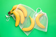 canvas print picture - Eco bags with bananas on color background