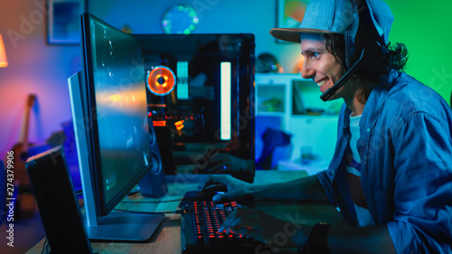 Professional Gamer Playing First-Person Shooter Online Video Game on His Powerful Personal Computer Wallpaper Mural