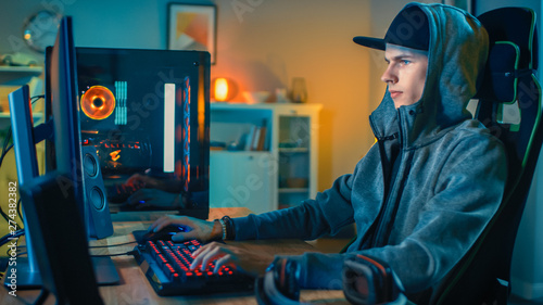 Professional Gamer or Streamer Playing First-Person Shooter Online Video Game on His Cool Personal Computer Canvas Print