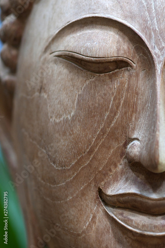 Fotografie, Obraz  The face of the Buddha-Wooden