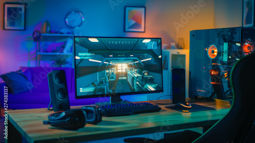 Powerful Personal Computer Gamer Rig with First-Person Shooter Game on Screen Wallpaper Mural