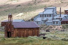 Old Mining Building Behind Old Wooden Houses, Ghost Town, Old Gold Mining Town, Bodie State Historic Park, Bodie, California, USA, North America