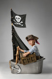Boy play pirate on the ship