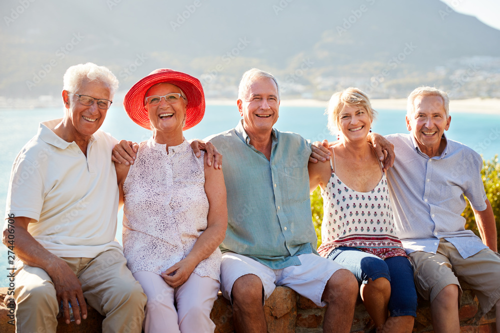 Fototapety, obrazy: Portrait Of Senior Friends Visiting Tourist Landmark On Group Vacation