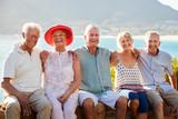 Portrait Of Senior Friends Visiting Tourist Landmark On Group Vacation - 274406706