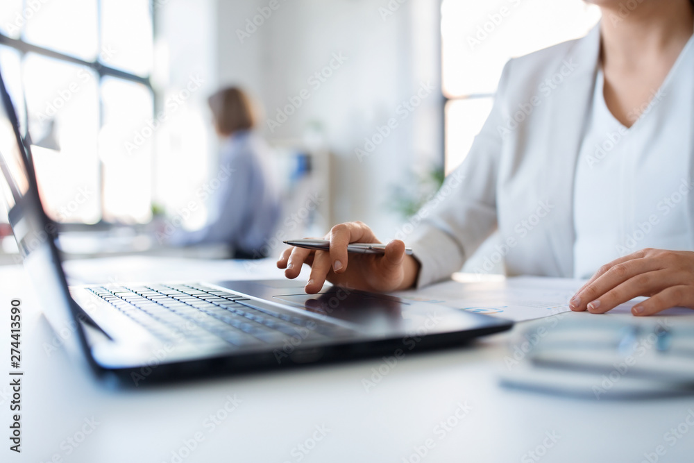 Fototapeta business and people concept - businesswoman with laptop computer and papers working at office