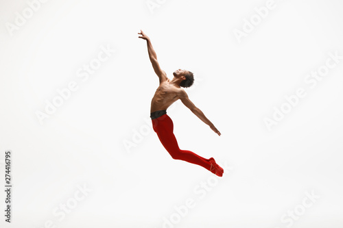 Keuken foto achterwand Gymnastiek Graceful classic ballet dancer dancing isolated on white studio background. Man in bright red clothes like a combination of wine and milk. The dance, grace, artist, movement, action and motion concept