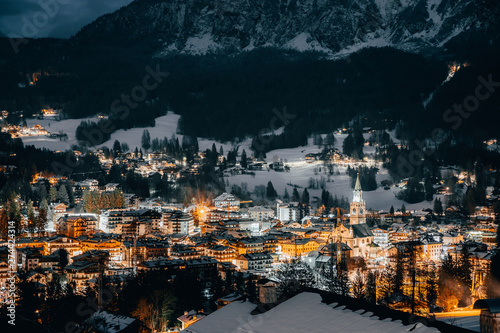 Scenic night view over Cortina d'Ampezzo in winter. Cortina d'Ampezzo is located in Dolomites, Italy. - 274424314