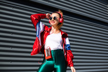 Back In Time 90s 80s. Stylish Girl In Retro Jacket And Vintage Cassette Player Listens To Music, Fashion Trends, Entertainment, Heat In Summer