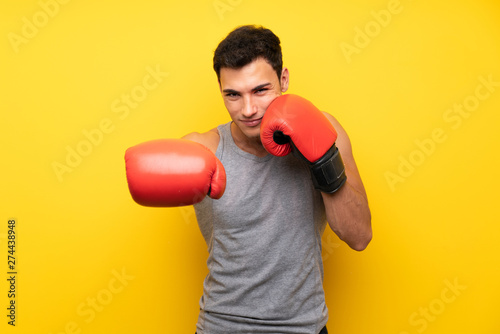 Valokuva  Handsome sport man over isolated background with boxing gloves