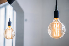Edison Lamp Is Included In Loft Room, Against Background Of Concrete Wall
