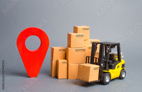 Yellow Forklift truck with cardboard boxes and a red