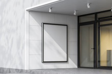 Mock Up Banner On White Building Wall