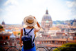 Rome Europe Italia travel summer tourism holiday vacation background -young smiling girl with mobile phone camera and map in hand standing on the hill looking on the cathedral Vatican