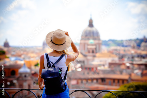 Fototapeta Rome Europe Italia travel summer tourism holiday vacation background -young smiling girl with mobile phone camera and map in hand standing on the hill looking on the cathedral Vatican obraz